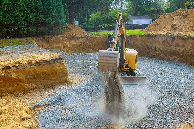 Machine laying gravel for a building foundation in Gresham